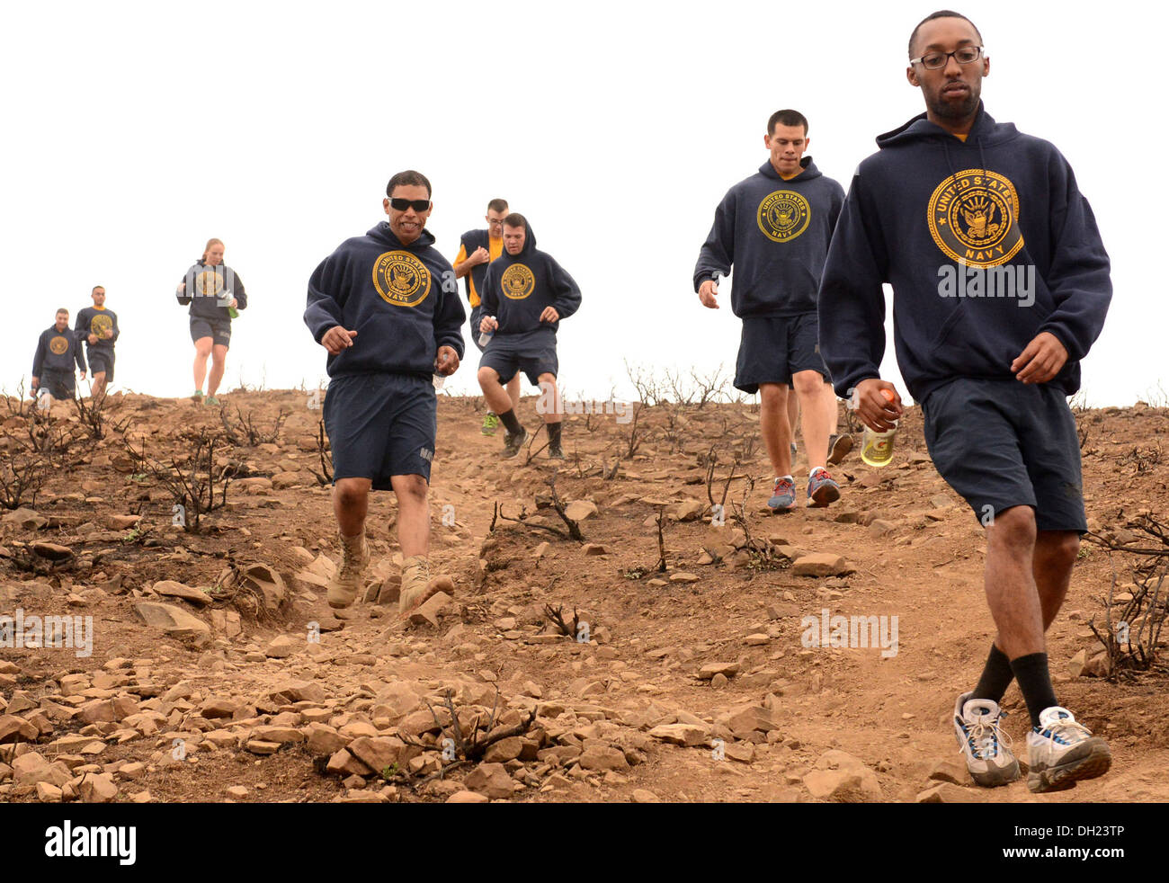 Santa Monica Mountains, Calif. (October 23, 2013) Builder 3rd Class Terrell Harris, from Hampton,Va., leads other Seabees as they descend down the Chumash Trail during physical training (PT). Seabees assigned Naval Mobile Construction Battalion (NMCB) 5's - Stock Image