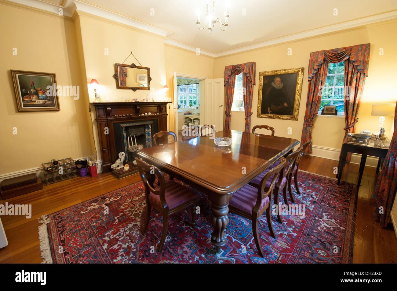 Large Formal Dining Room Oak Dinner Table - Stock Image