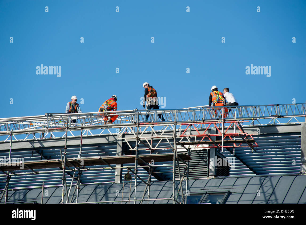 Roofers working on Scaffolding safety Harness H&S - Stock Image