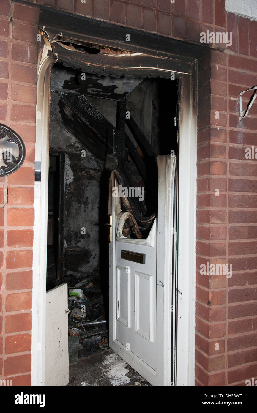 House Front Door Sever Fire Burnt Melted Hot Rescue - Stock Image