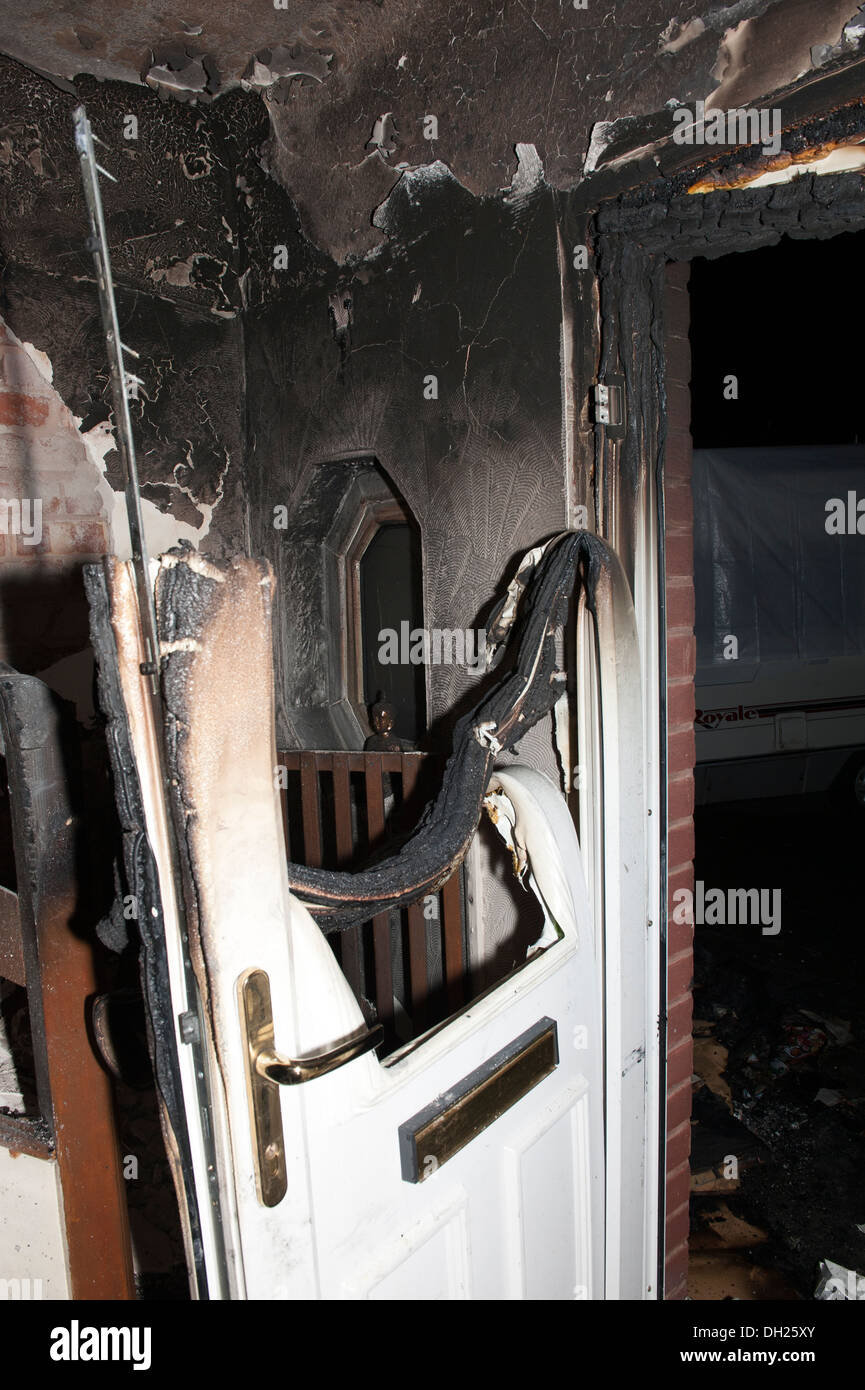 House Front Door Sever Fire Burnt Melted Hot - Stock Image