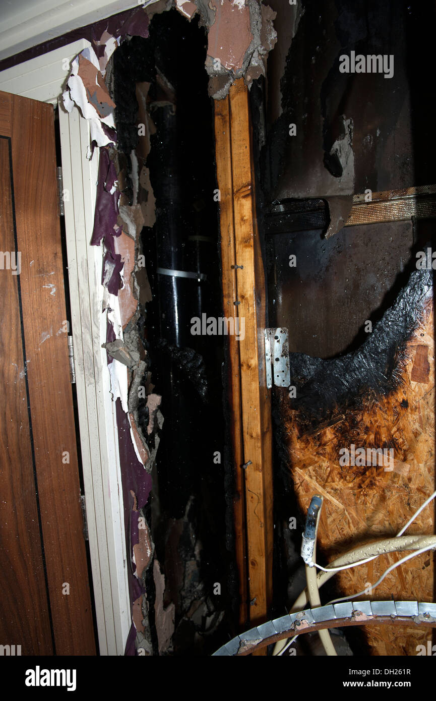 Wood cavity wall void fire spread burnt cut away - Stock Image
