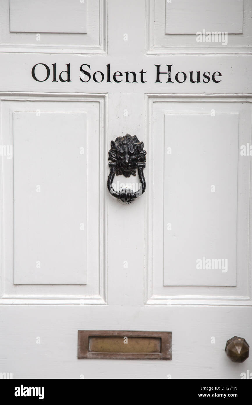 black front door handles. White Front Door - Detail Of Traditional English House With Black Lion Knocker, Brass Handle And Letter Box Handles D