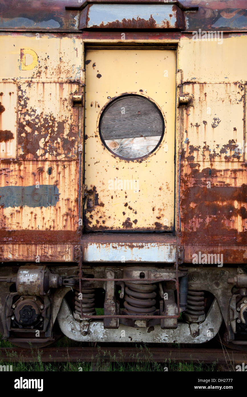 Entrance to rusted and dilapidated antique Milwaukee Road passenger car. Great Northern Railroad Spooner Wisconsin WI USA - Stock Image