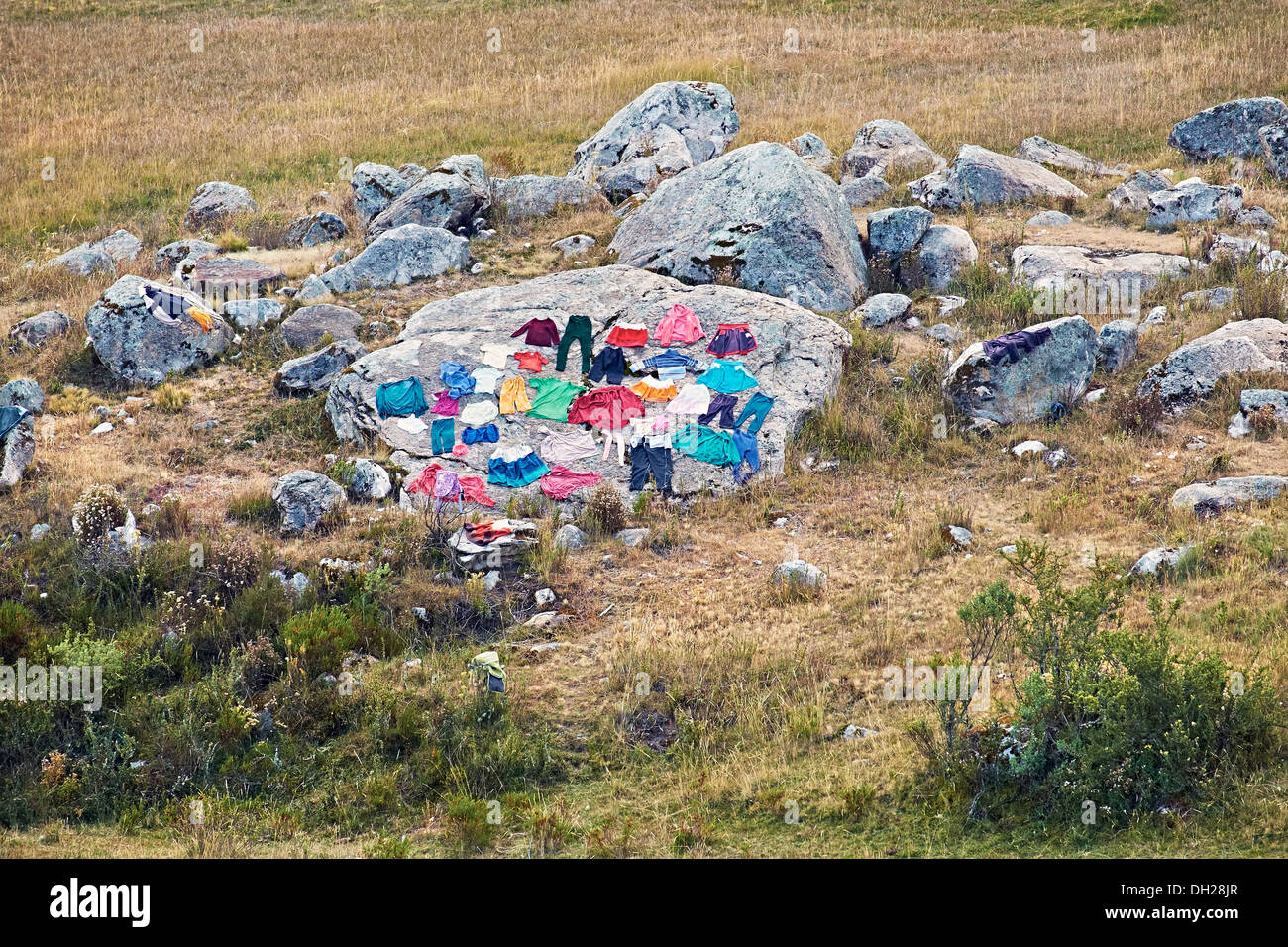 Drying cloths on a rock high up in the Andes, Peru, South America - Stock Image