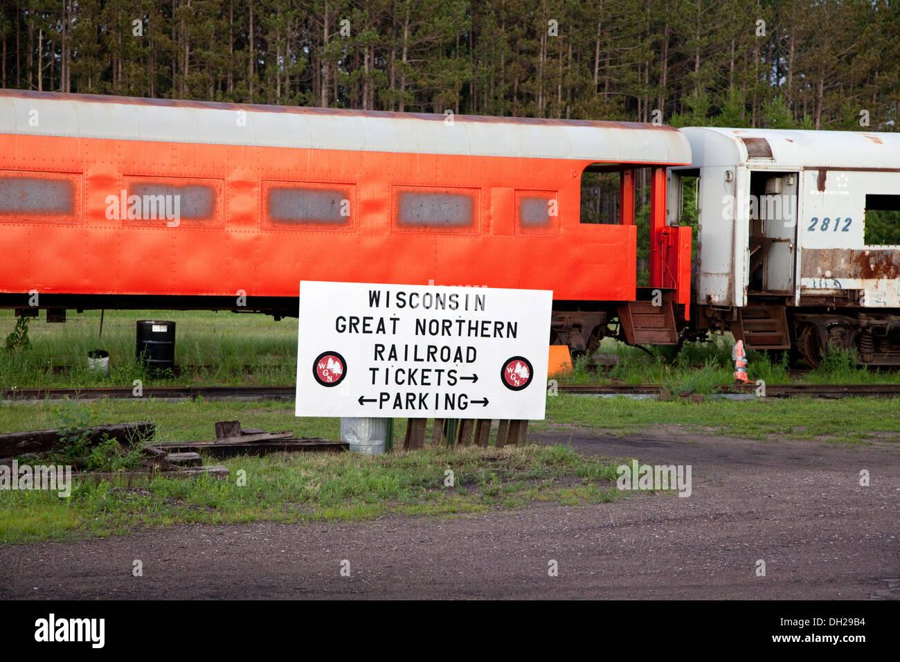 Orange restored antique passenger railroad car. Great Northern Railroad Spooner Wisconsin WI USA - Stock Image