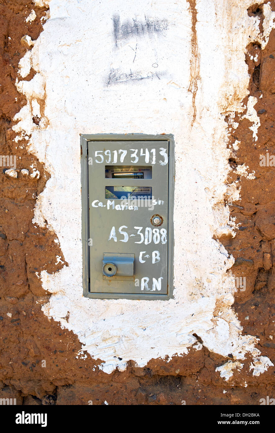 An electric meter on an adobe building in the Peruvian Andes, South America. - Stock Image