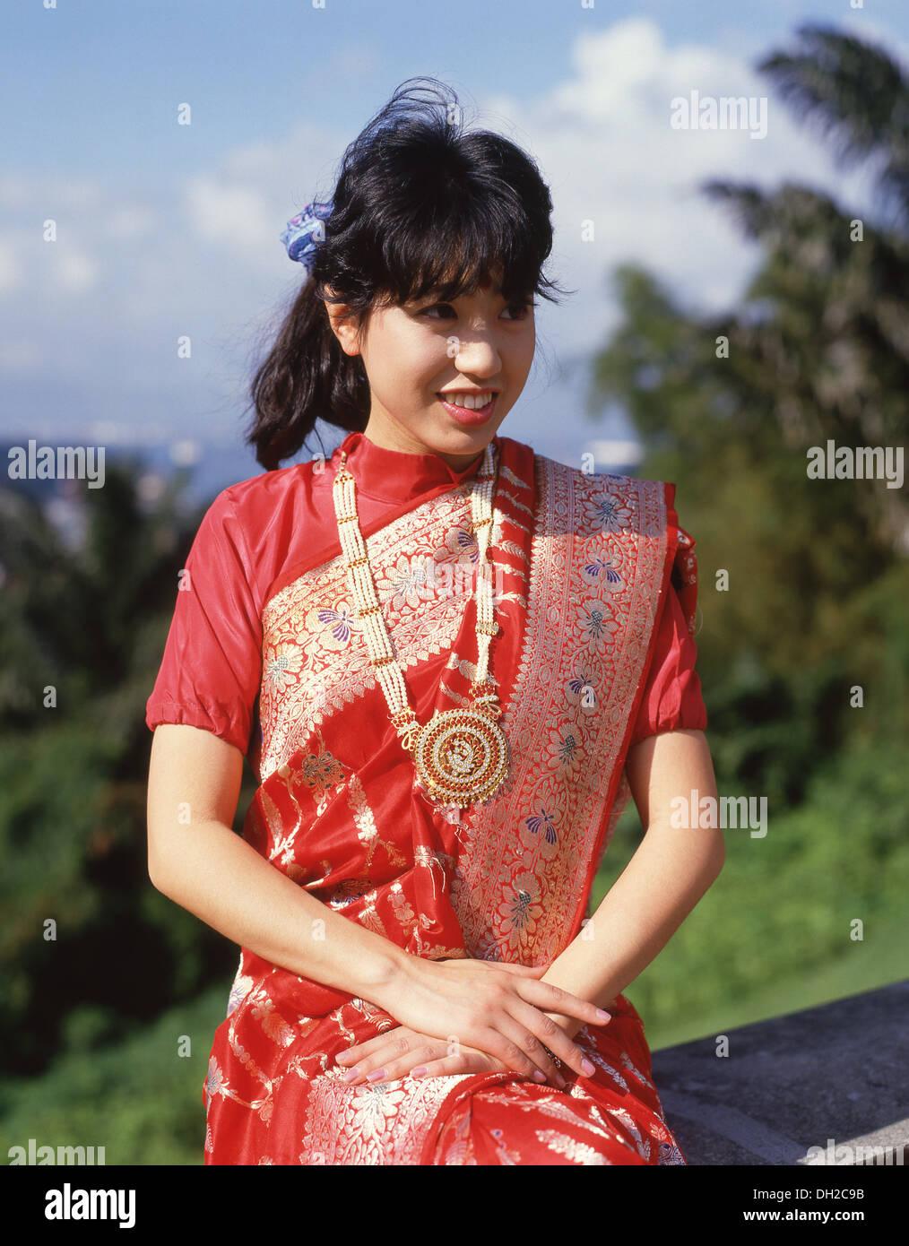 Japanese woman wearing traditional silk dress, Honshu, Japan - Stock Image