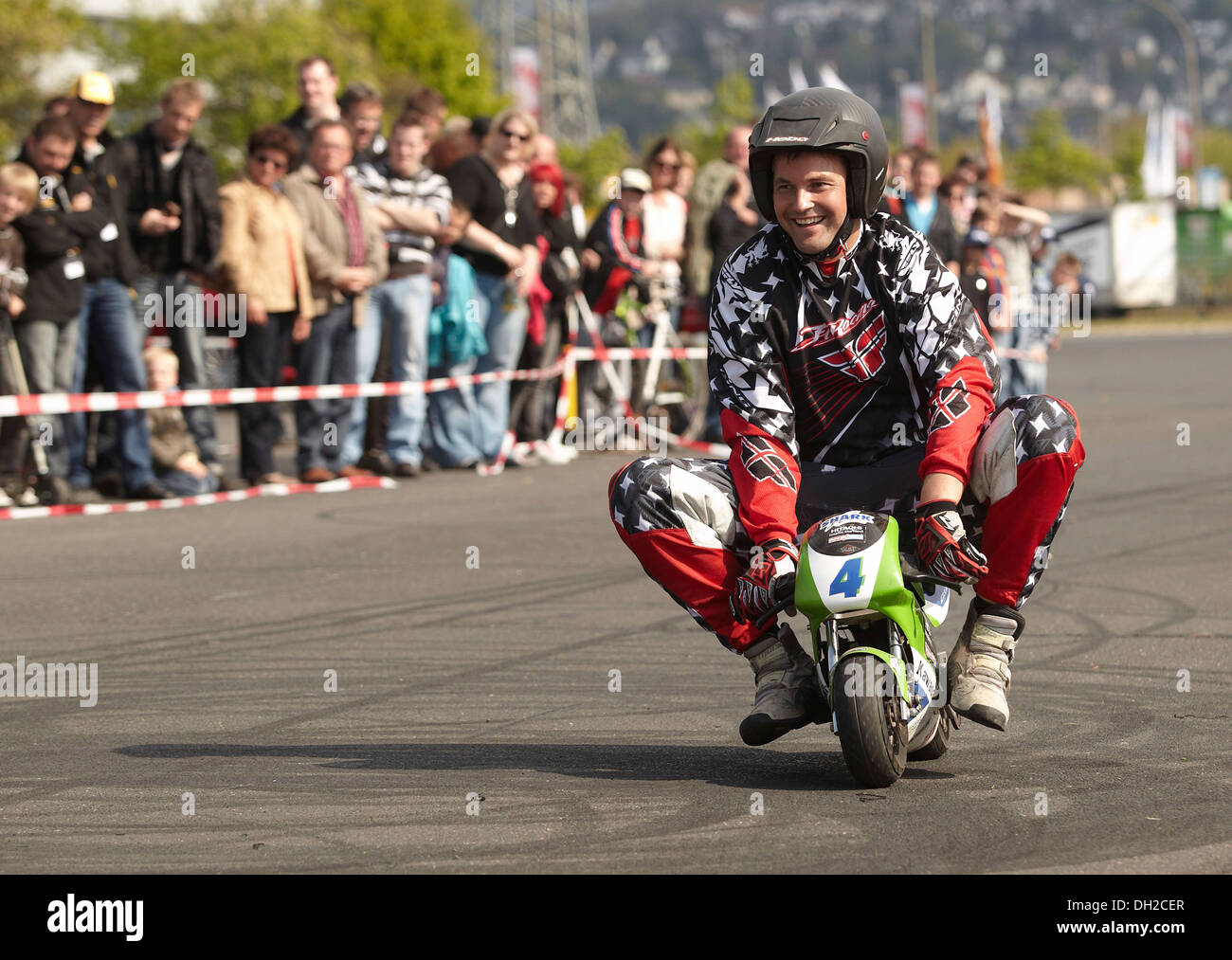 Motorcycle stuntman Mike Auffenberg riding a pocket bike, Koblenz, Rhineland-Palatinate Stock Photo