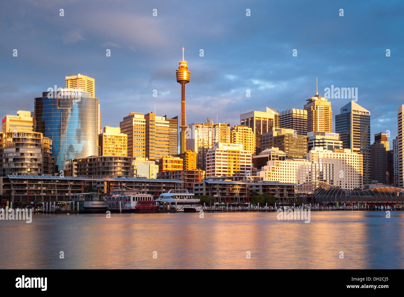 The view towards Sydney CBD and King St Wharf from Darling Harbour on a warm spring evening - Stock Image