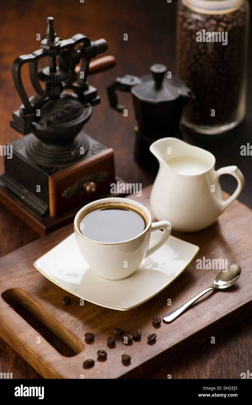 Coffee with milk in a traditional vintage setting Stock Photo