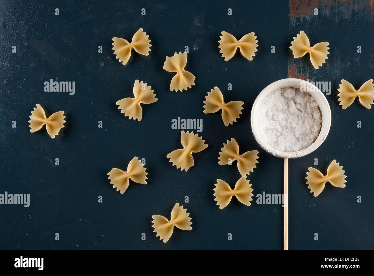 Farfalle pasta, concept of butterflies around a flower - Stock Image