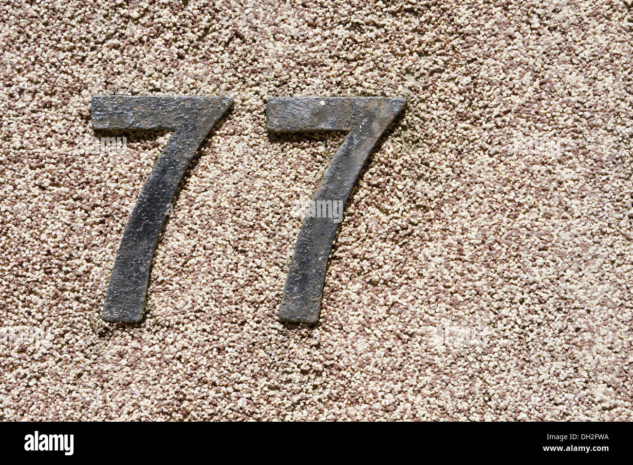 house number 77 - Stock Image