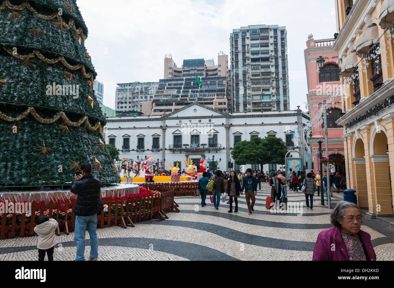Tourists and shoppers wander around Senado Square in Macau, China. - Stock Image