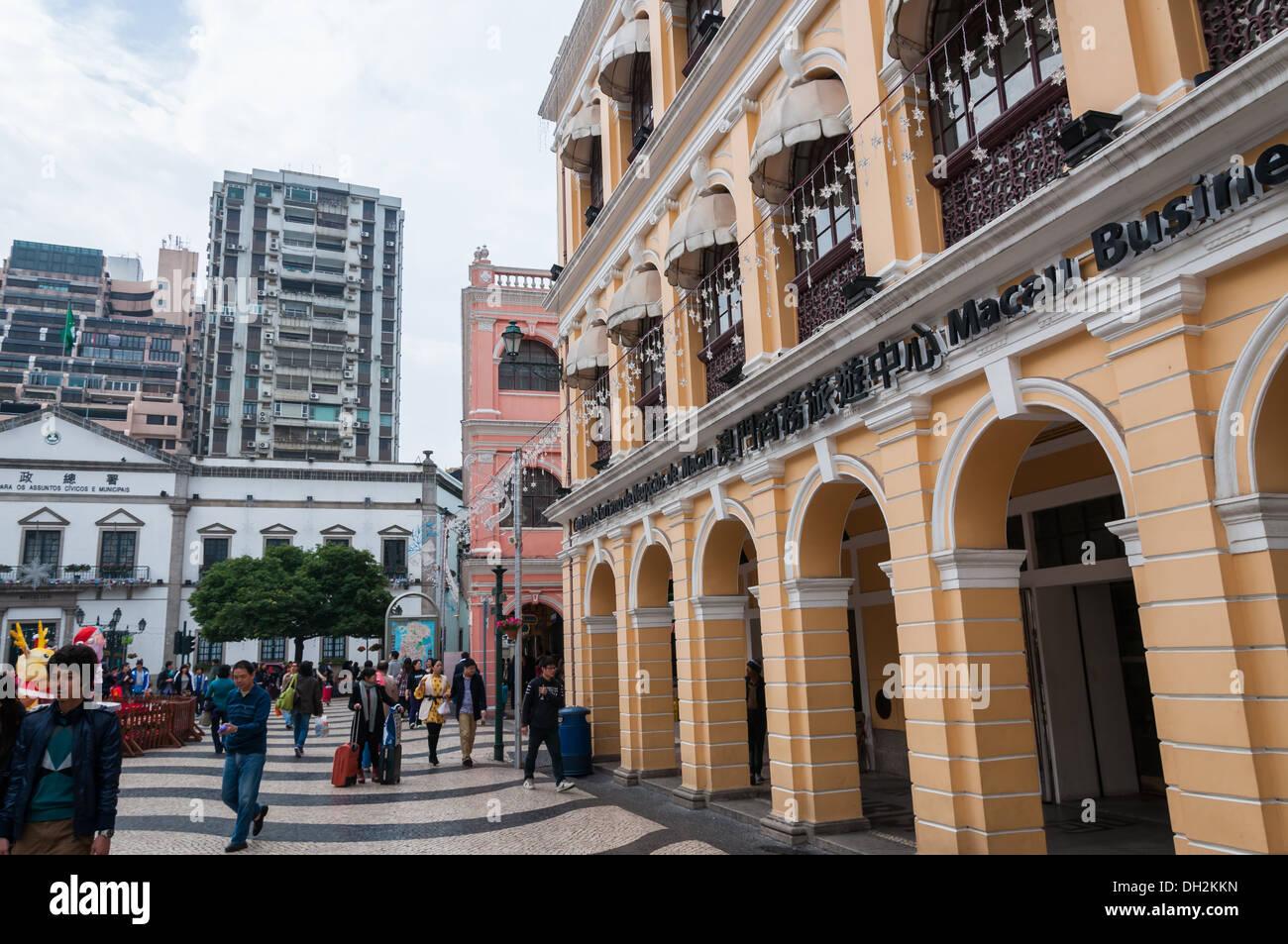 Tourists and shoppers wander around Senado Square in Macau, China. - Stock Image