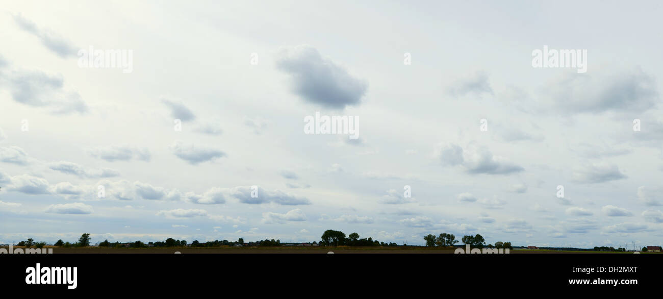 clouds on the sky or panoramic landscape with horizon, stormy weather - Stock Image