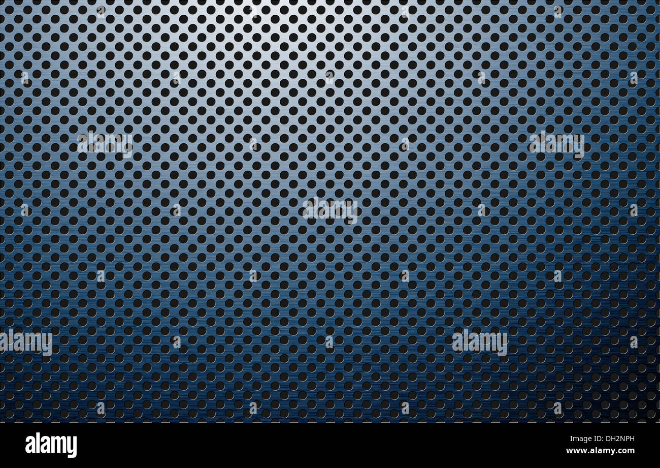 perforated polished metal surface - Stock Image