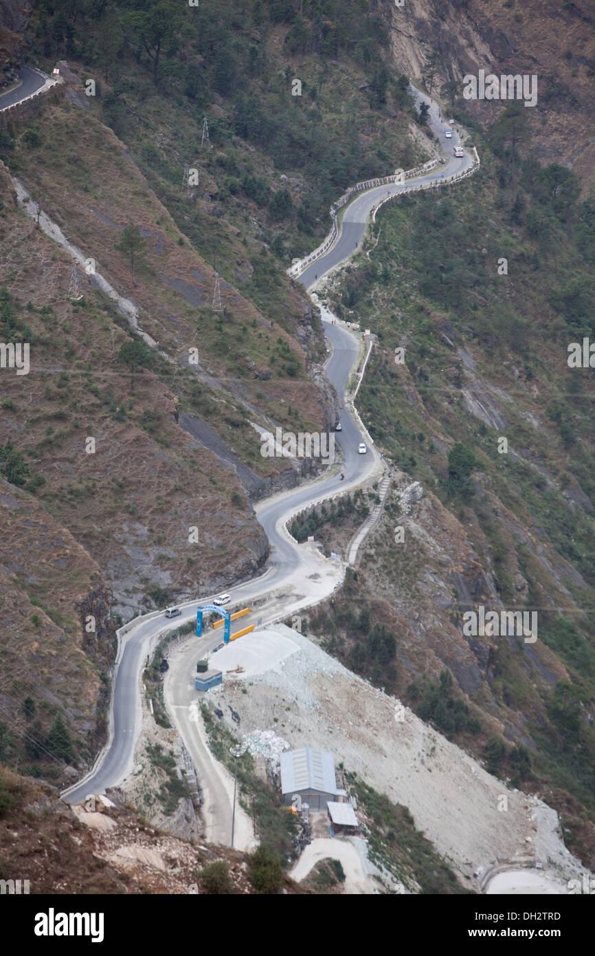 mountain road with curves Uttarakhand India Asia - Stock Image