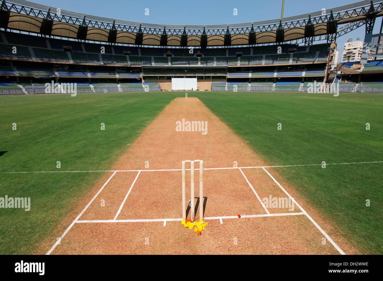 cricket pitch with stumps Wankhede Stadium Mumbai Maharashtra India Asia - Stock Image