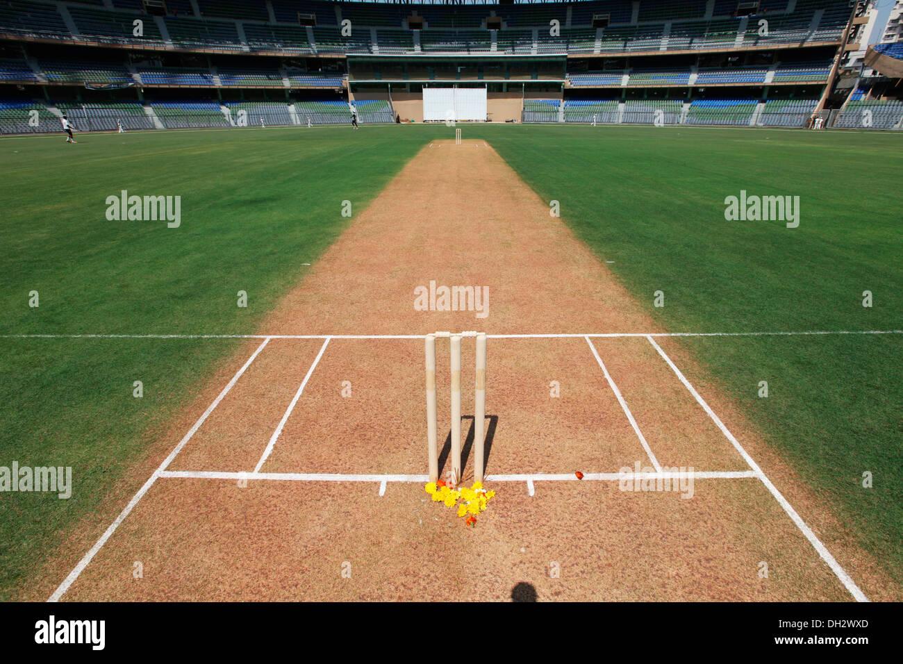 stumps and cricket pitch Wankhede Stadium Mumbai Maharashtra India Asia - Stock Image