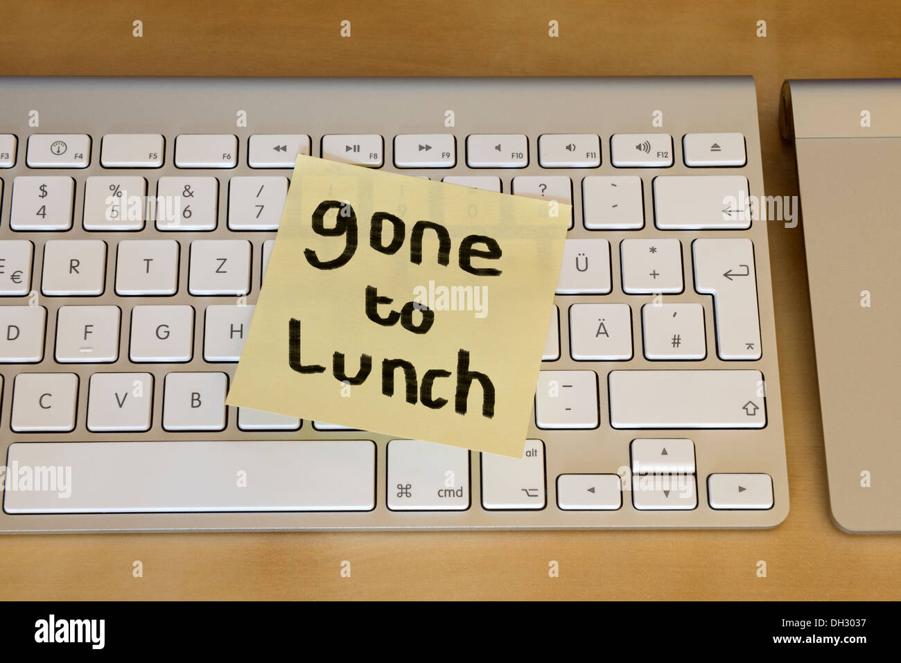 Gone to lunch note on keyboard - Stock Image