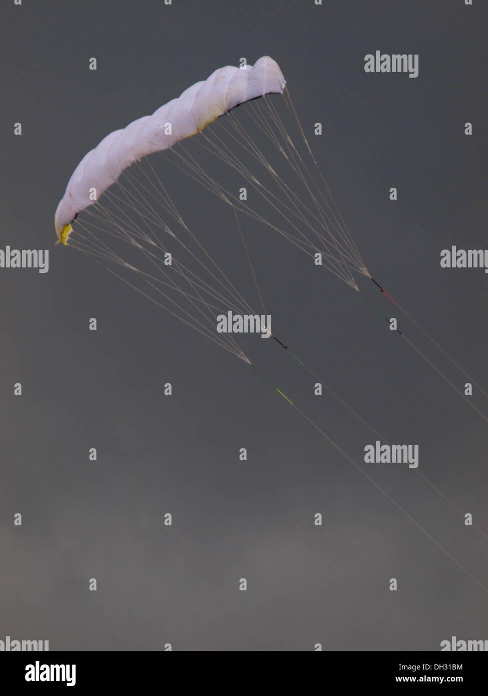 White power kite on a grey day, Cornwall, UK - Stock Image