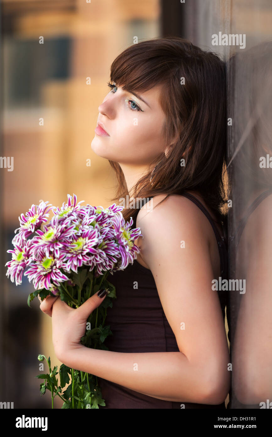Sad Young Woman With A Flowers Stock Photo 62147541 Alamy