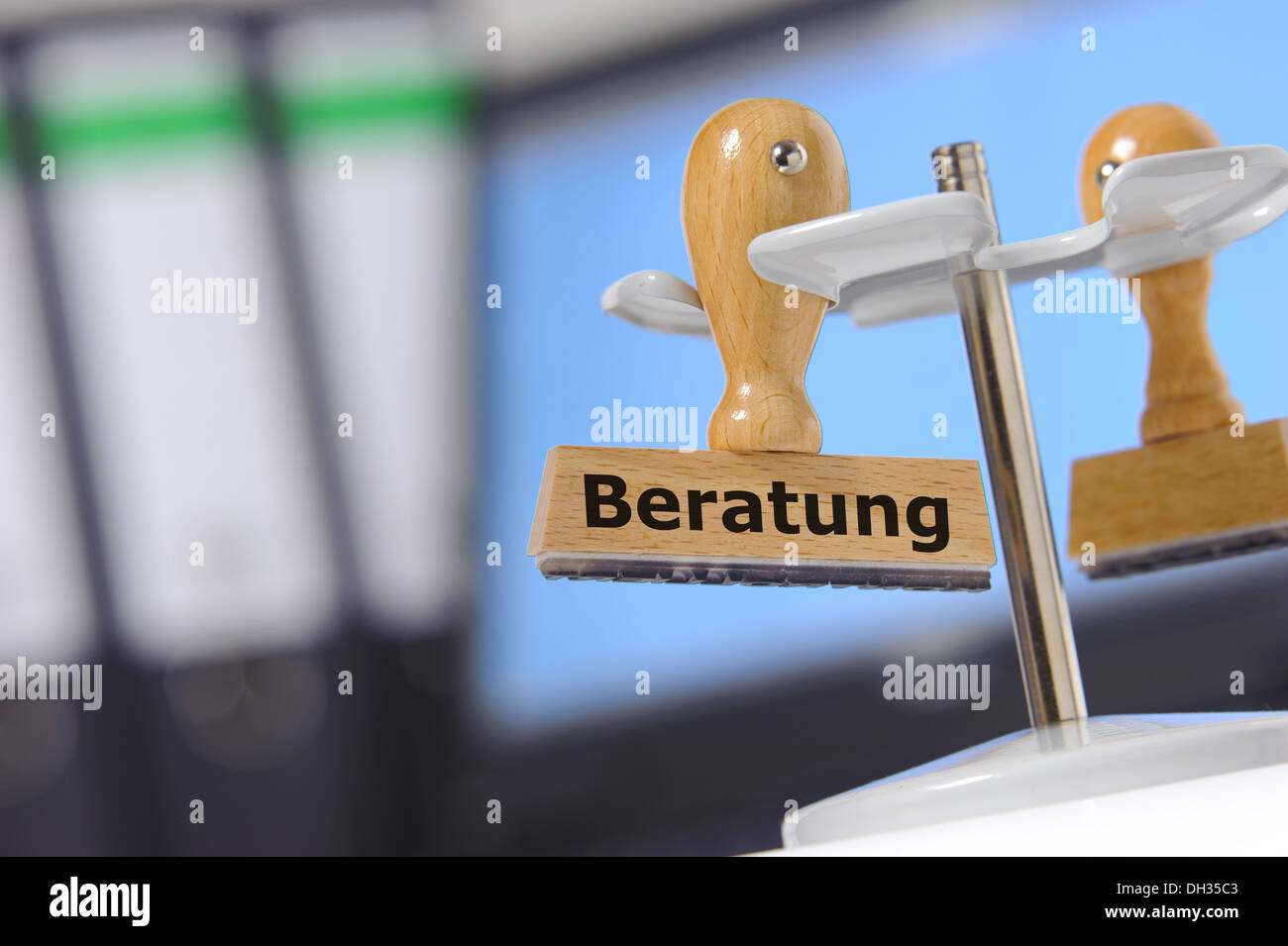 stamp marked in german: consulting - Stock Image