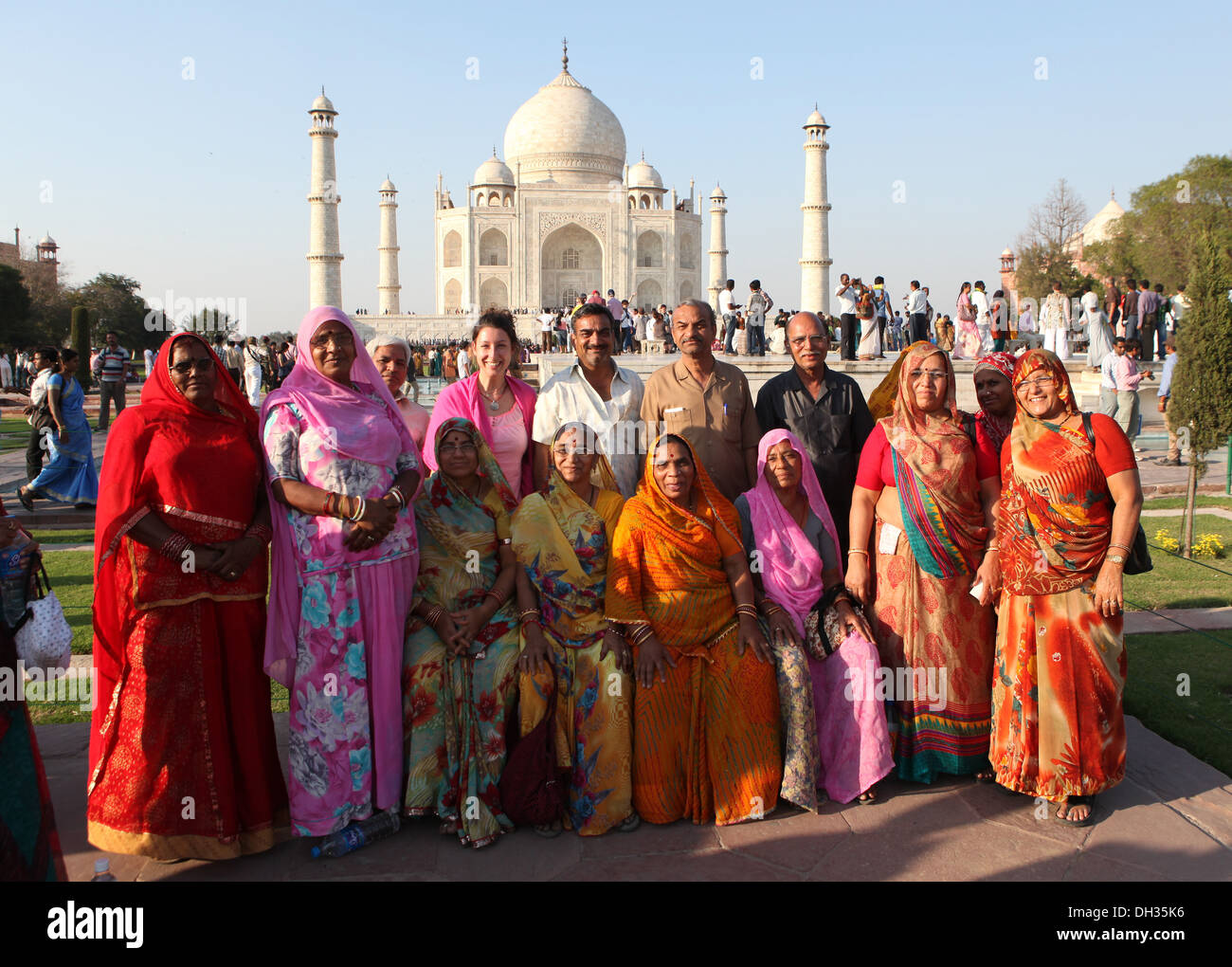 Group of Indian tourists posing in front of the Taj Mahal, Agra, Uttar Pradesh, India, Asia - Stock Image