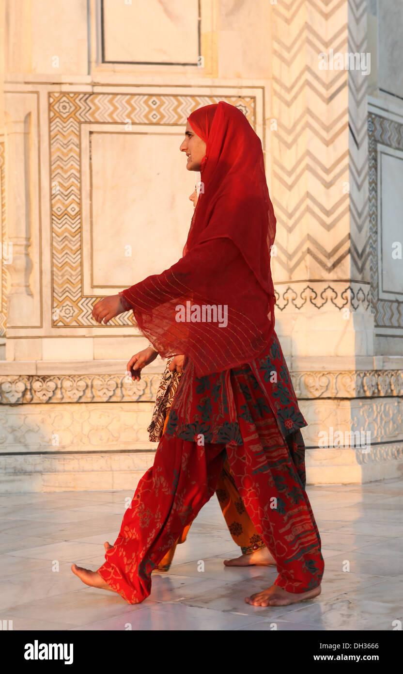 Two Indian women in shalwar pants at the Taj Mahal, Agra, Uttar Pradesh, India, Asia - Stock Image