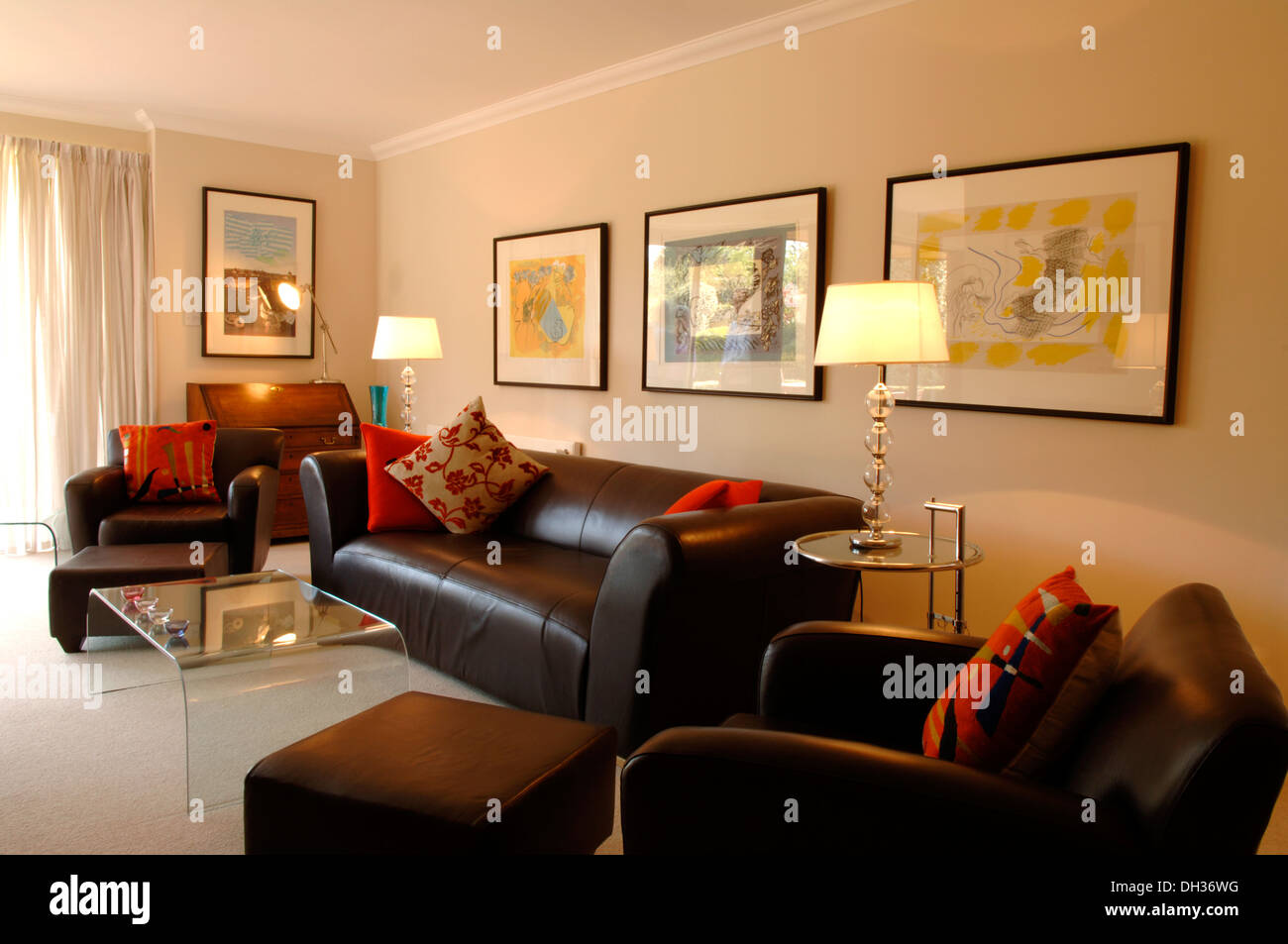 Living Room With Leather Sofa And Chairs, Glass Coffee Table, Red Throw  Cushions, Two Lamps And Art On The Walls Cream Carpets