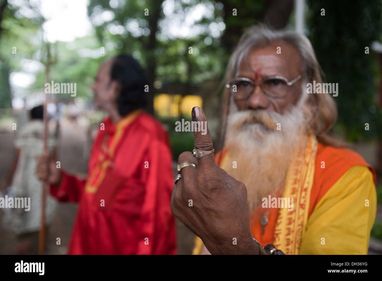 Indian sadhu showing finger marked after voting Mumbai Maharashtra India Asia - Stock Image