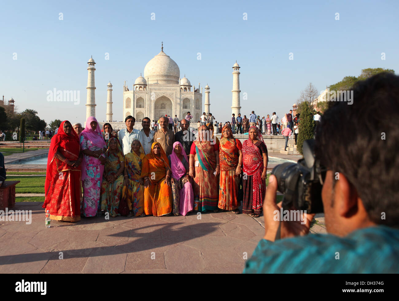 Indian tourists pose for a photo in front of the Taj Mahal, Agra, Uttar Pradesh, India, Asia - Stock Image
