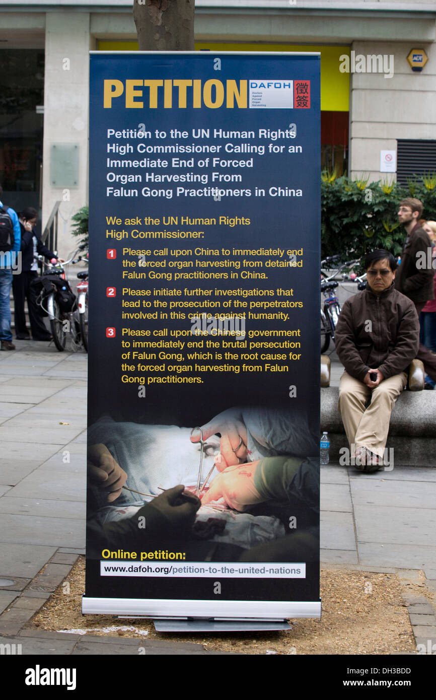 Organ Harvesting Atrocities in China Exposed Petition in China Town London Poster - Stock Image