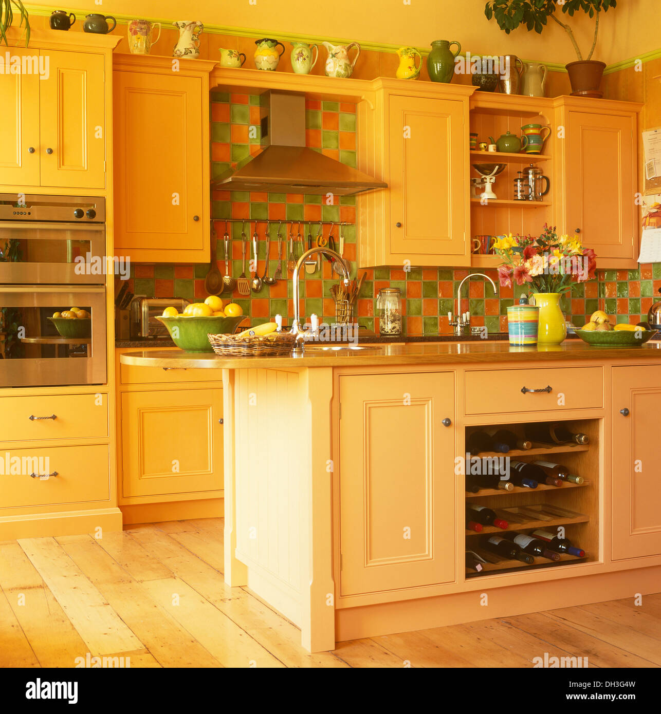 Genial Green+orange Tiles And Island Unit With Integral Wine Storage In Yellow  Kitchen With Pale Orange Units And Wooden Floor
