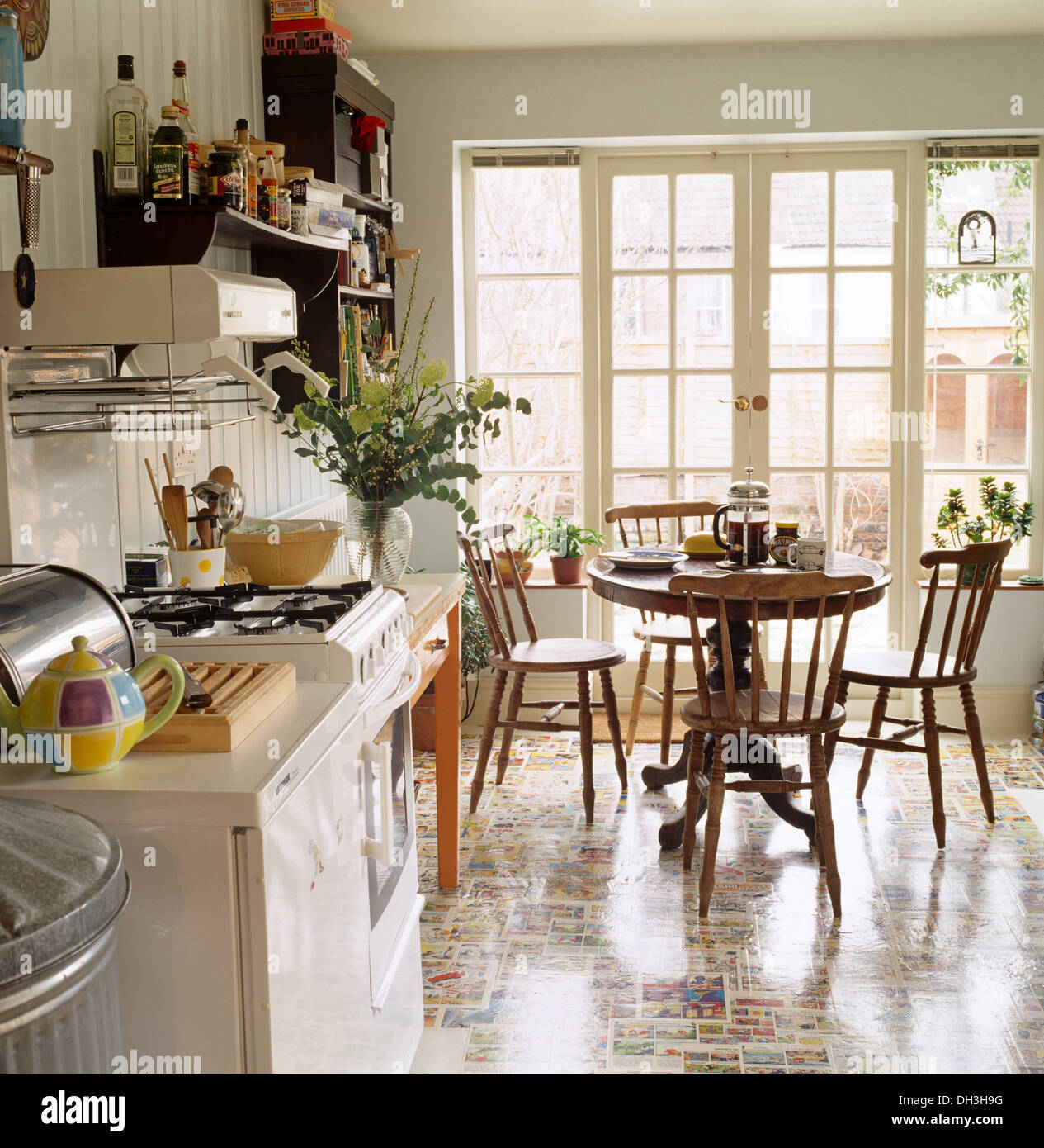 Colorful Flooring And Gas Oven In Kitchen Dining Room With Circular Stock Photo Alamy
