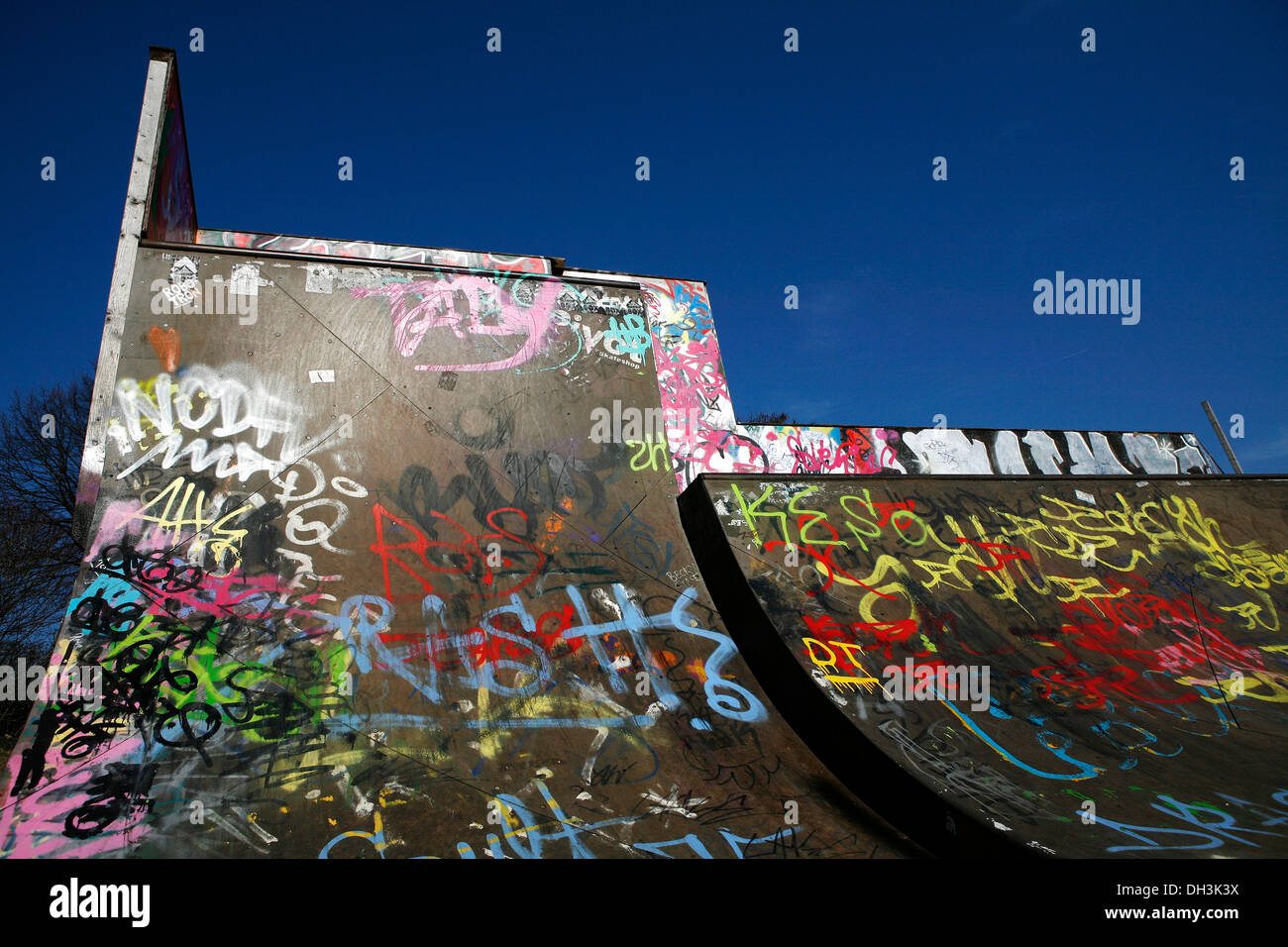 Skate park, halfpipe covered in graffiti, green belt of Cologne-Nippes, Cologne, North Rhine-Westphalia Stock Photo