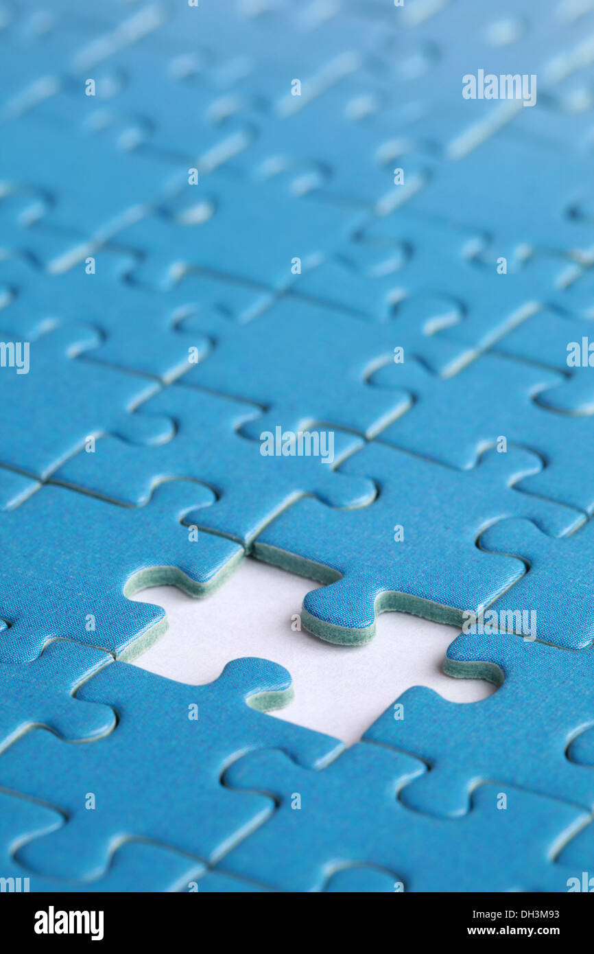 Missing piece in a jigsaw puzzle, concept problem solution - Stock Image