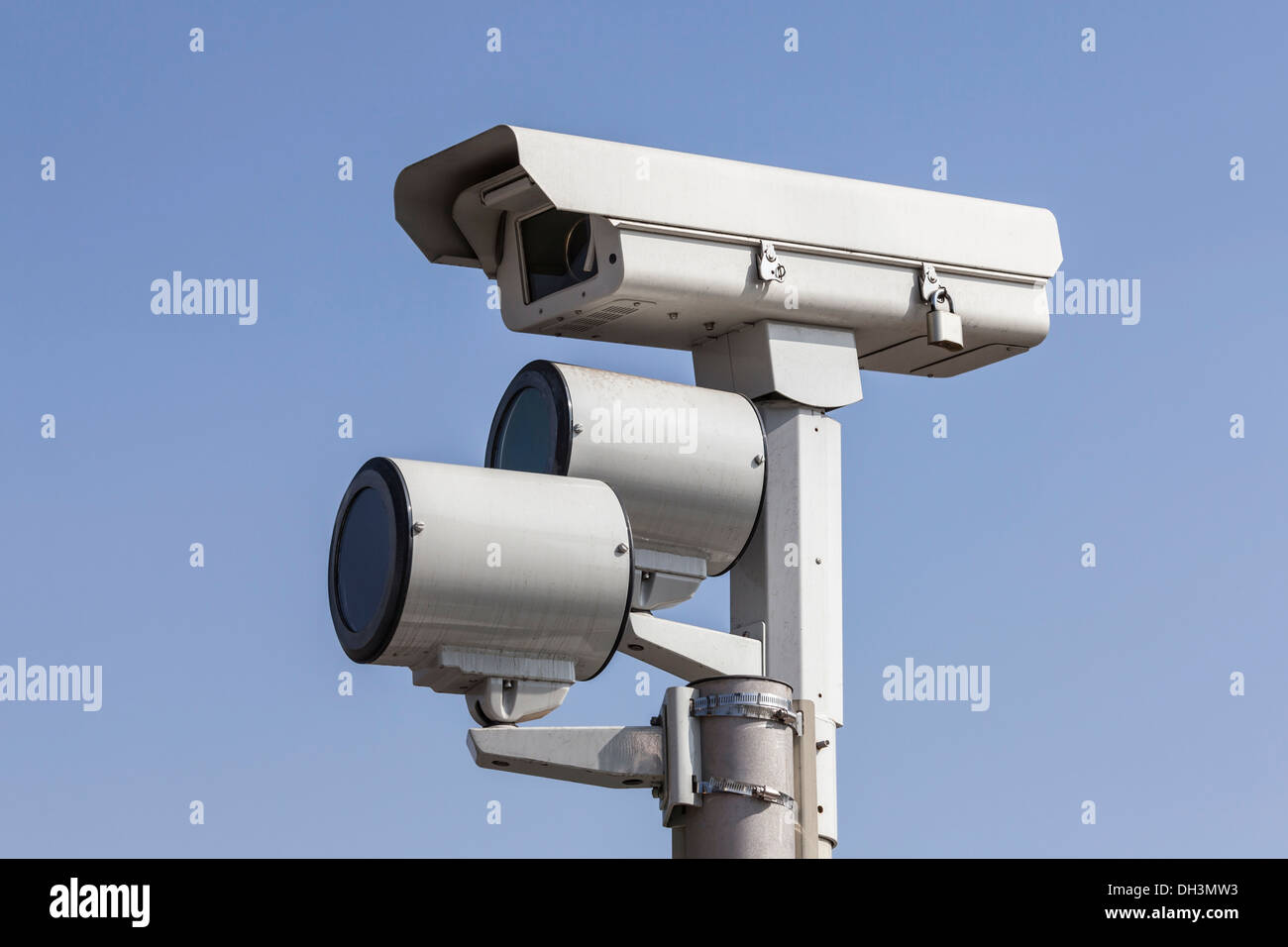 Traffic intersection signal surveillance camera with lights. - Stock Image