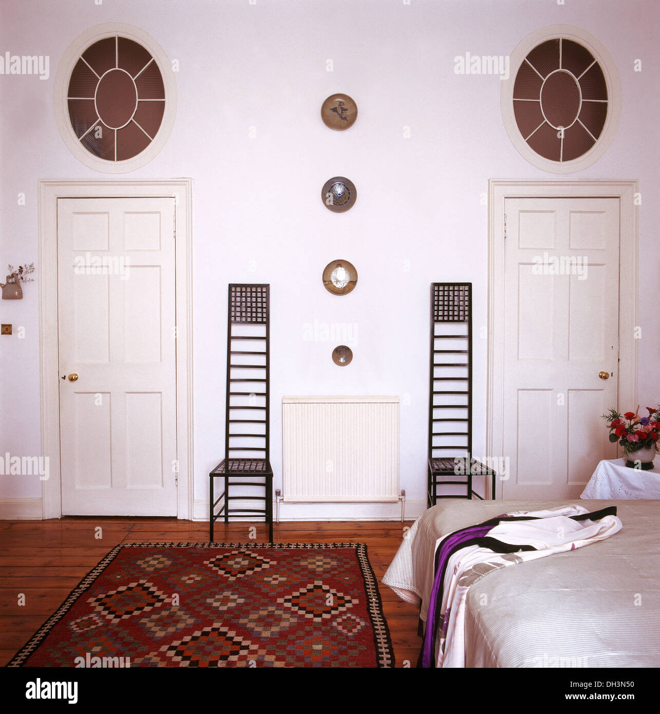 Charles Rennie Mackintosh chairs in white bedroom with ...