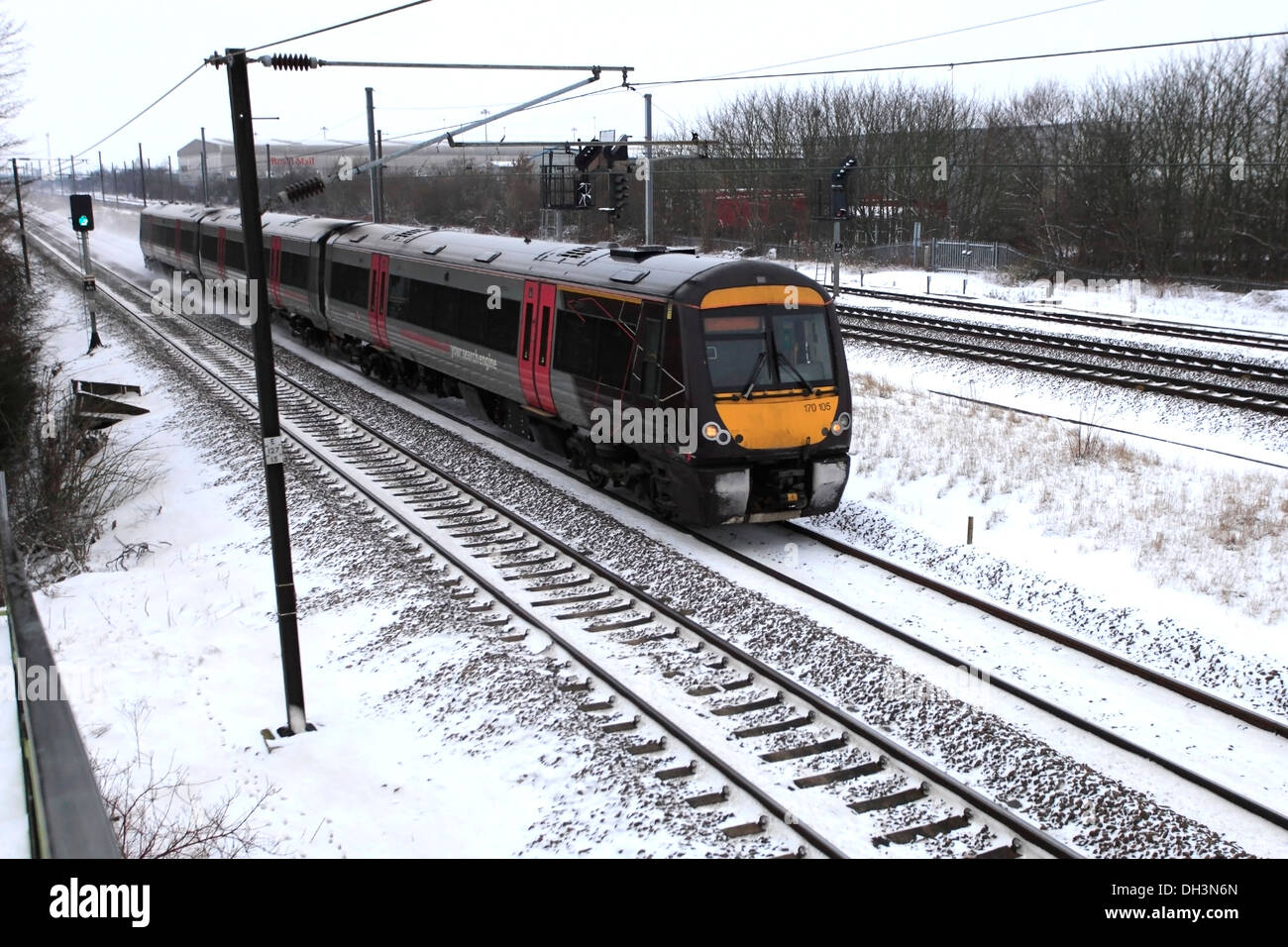 Snow, 170105 County 2 County trains, Turbostar class, High Speed Diesel Train, East Coast Main Line Railway, Cambridgeshire - Stock Image