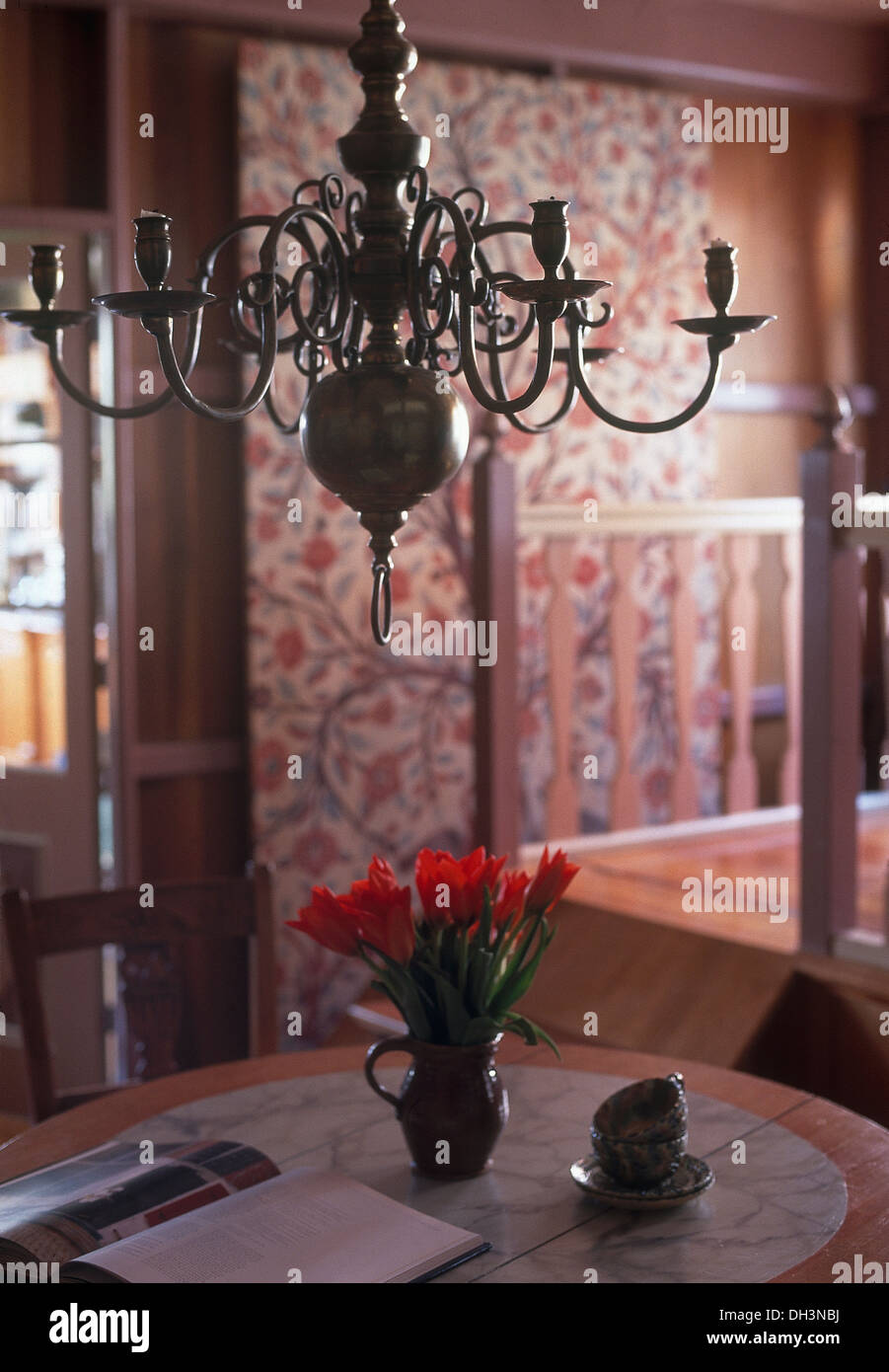 Peachy Antique Brass Chandelier Above Table With Jug Of Red Tulips Interior Design Ideas Tzicisoteloinfo