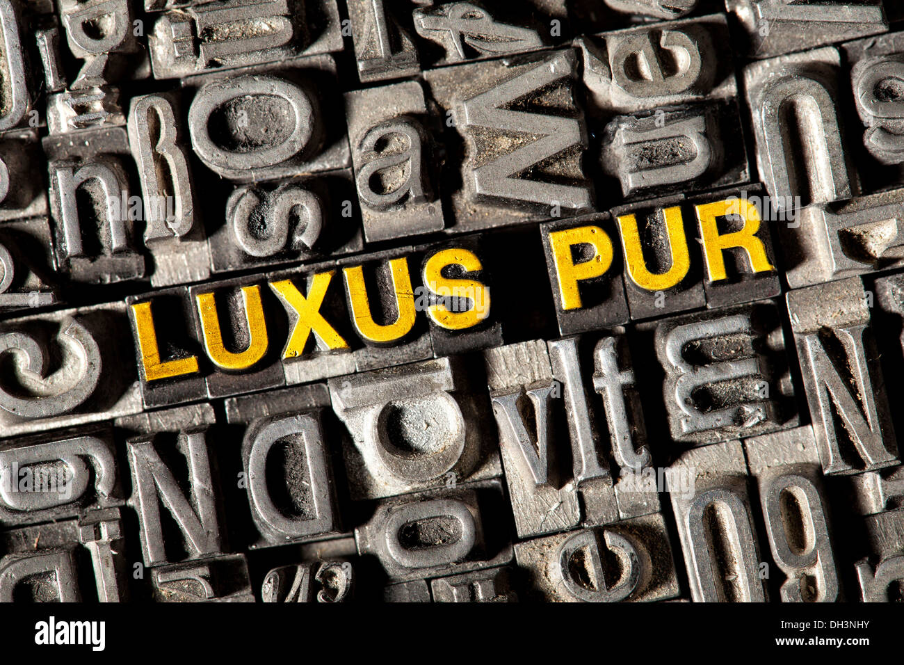 Old lead letters forming the word 'LUXUS PUR', German for 'sheer luxury' - Stock Image