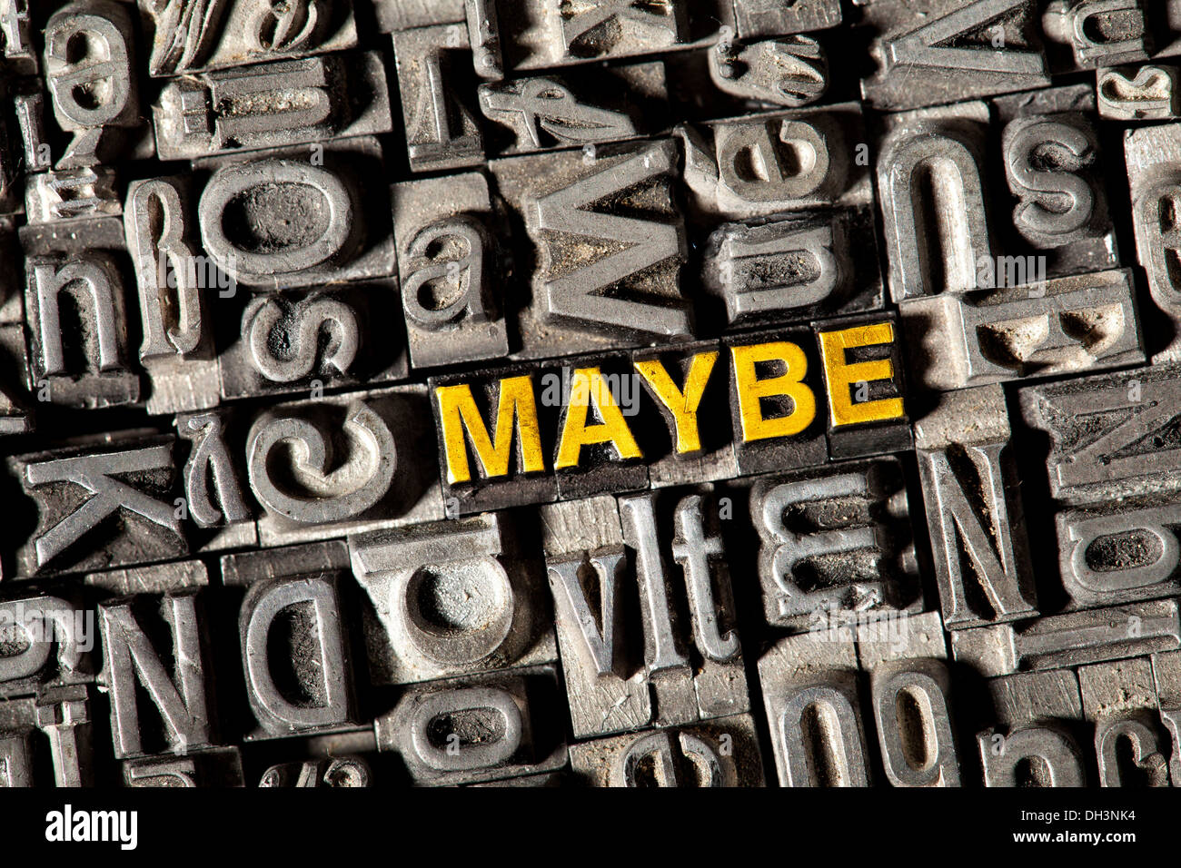 Old lead letters forming the word 'MAYBE' - Stock Image
