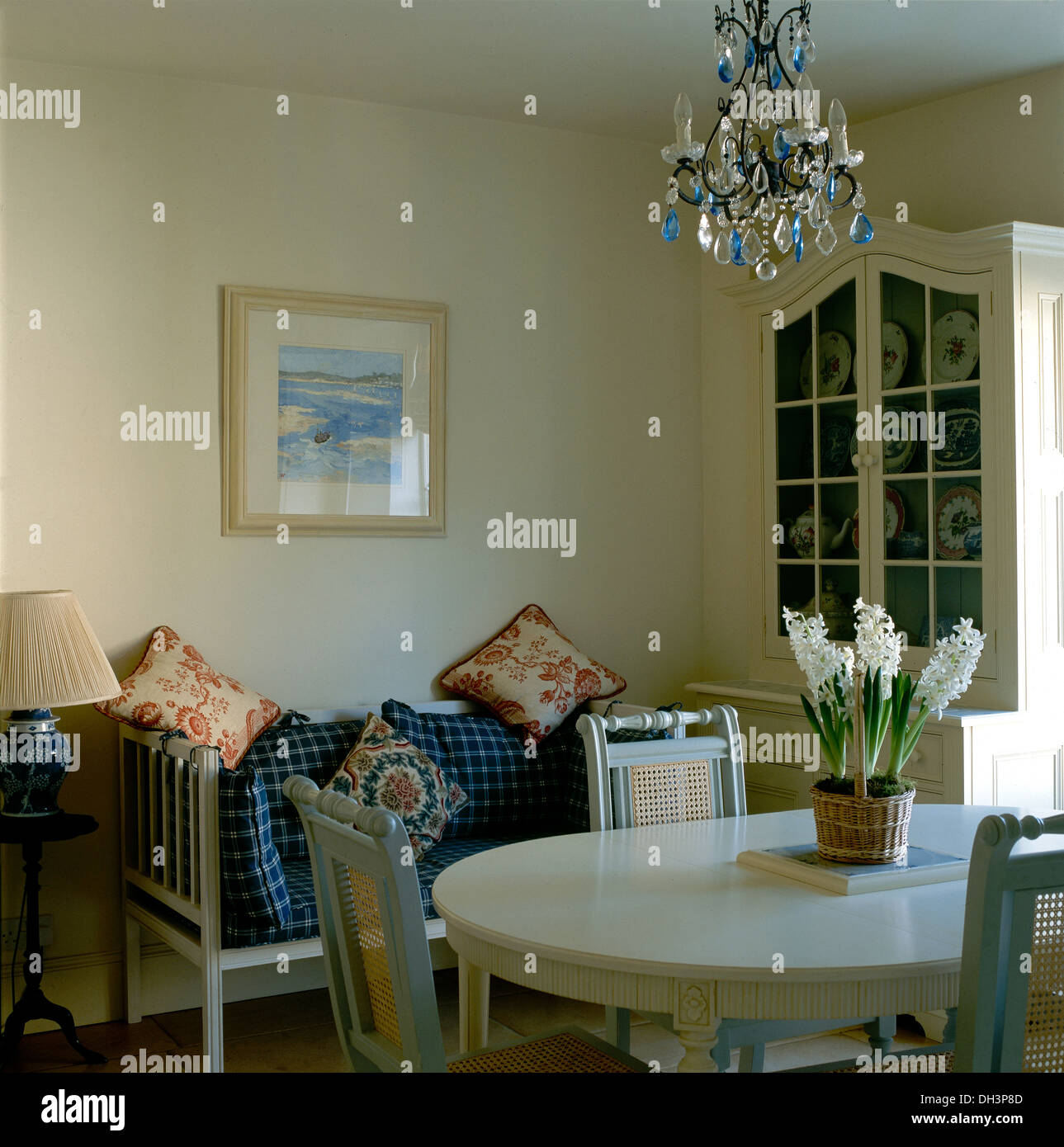 Outstanding Glass Chandelier Above Gray Chairs And Oval Table With Pot Dailytribune Chair Design For Home Dailytribuneorg