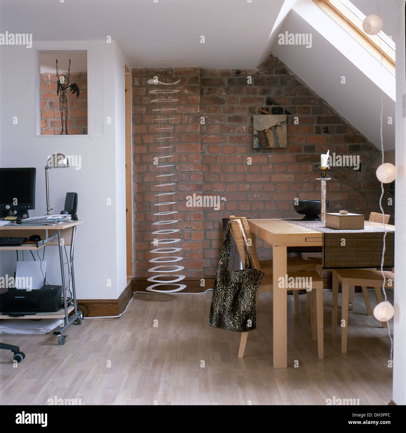 small loft furniture. Pale Wood Table And Chairs In Dining Area Of Small Loft Conversion With Metal Spiral Sculpture Against Exposed Brick Wall Furniture