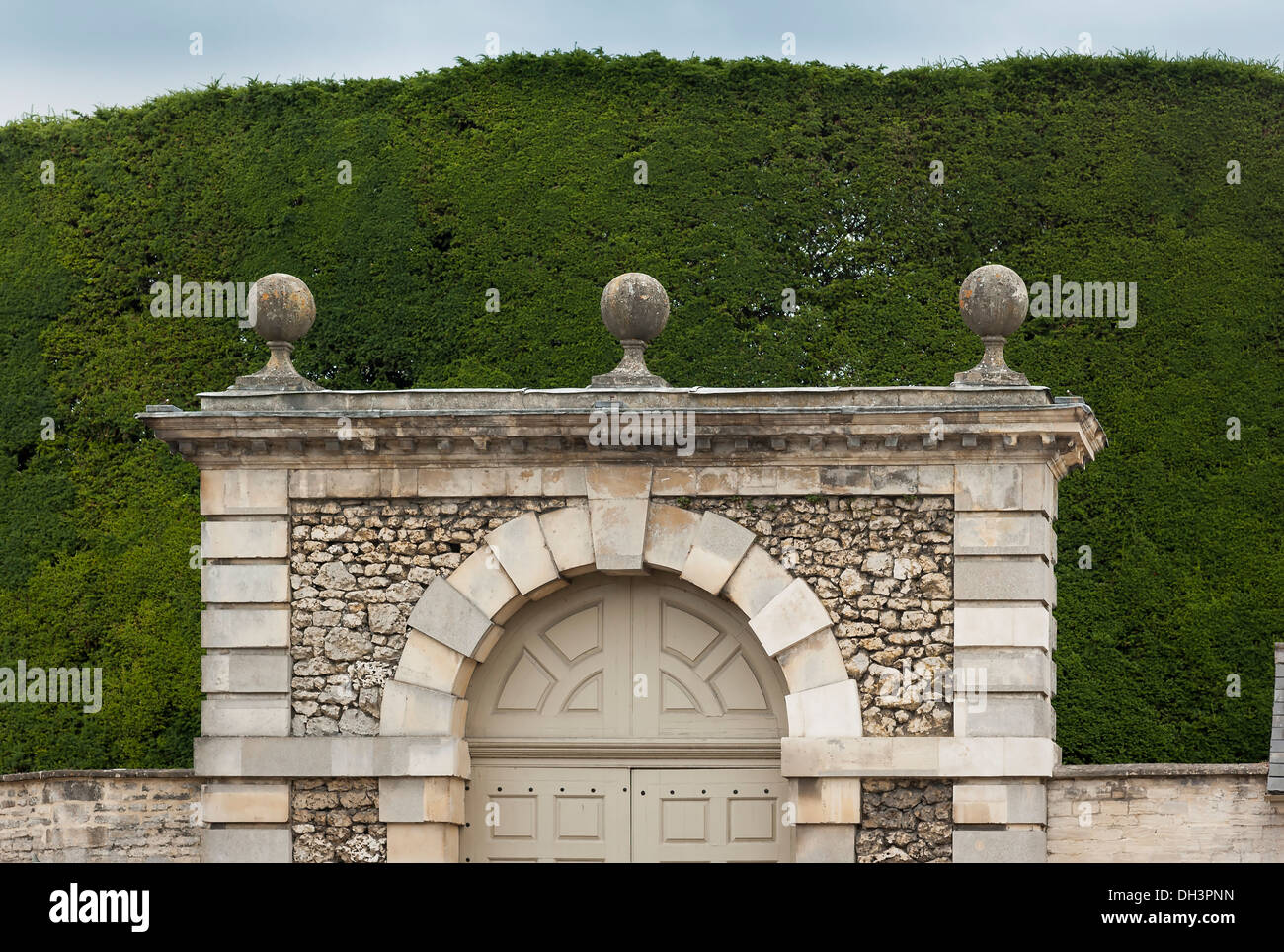 Use of tall mature conifer hedge to add privacy to a property in Cirencester UK - Stock Image