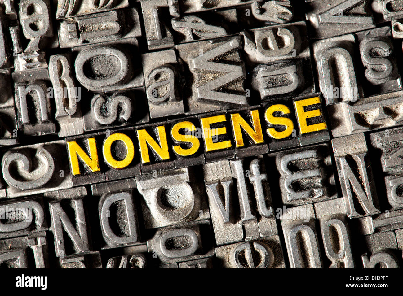 Old lead letters forming the word NONSENSE - Stock Image