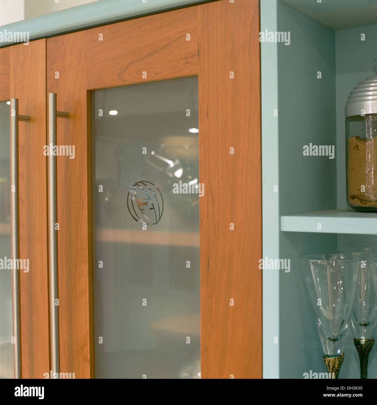 Close Up Of Modern Kitchen Cupboard Doors With Engraved Opaque