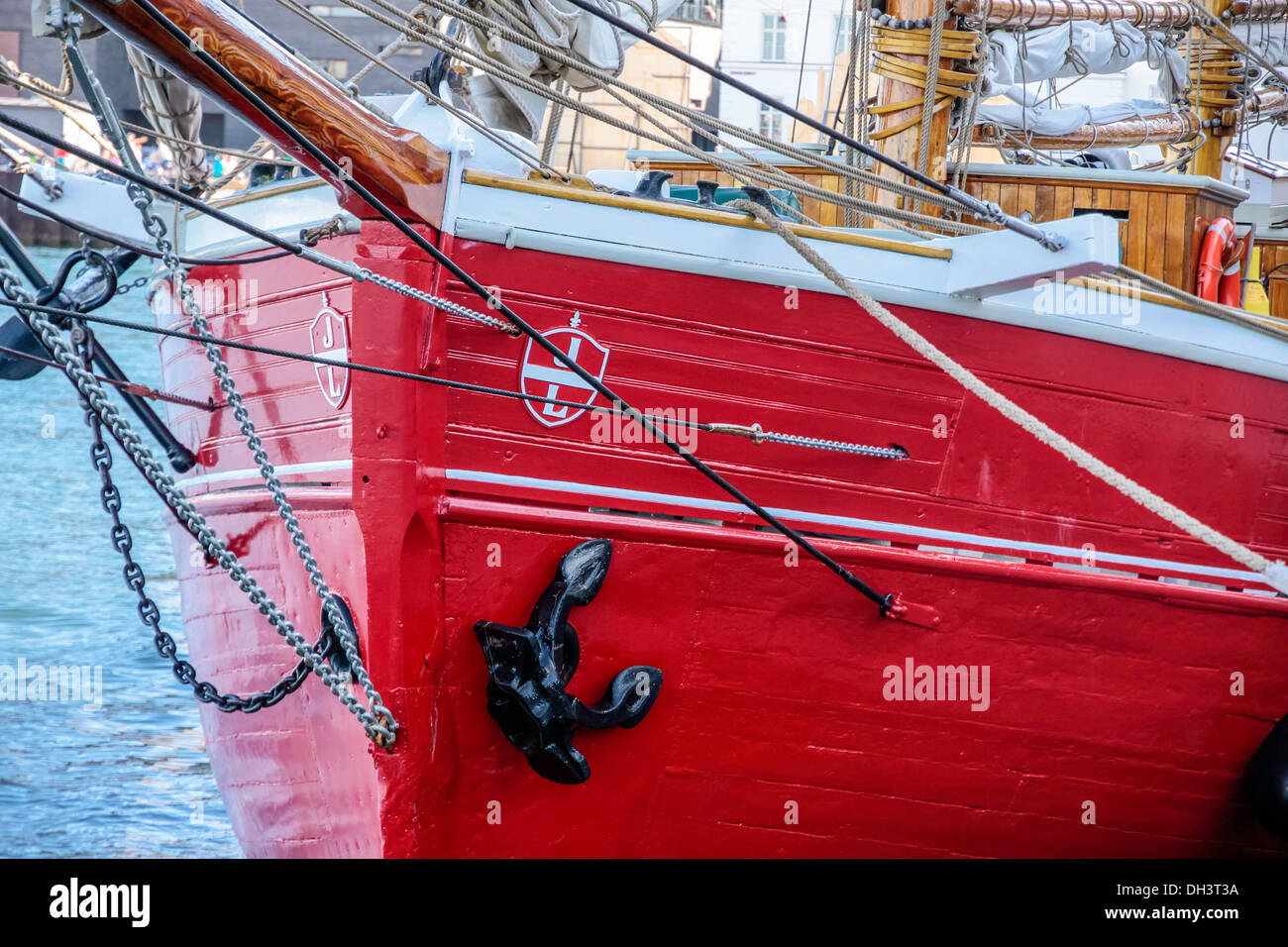 Red bow of an old sailing ship in Amaliehaven, Copenhagen, Denmark - Stock Image